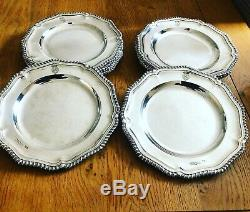 A Magnificent set of Twelve Sterling Silver Royal Victorian Dinner Plates